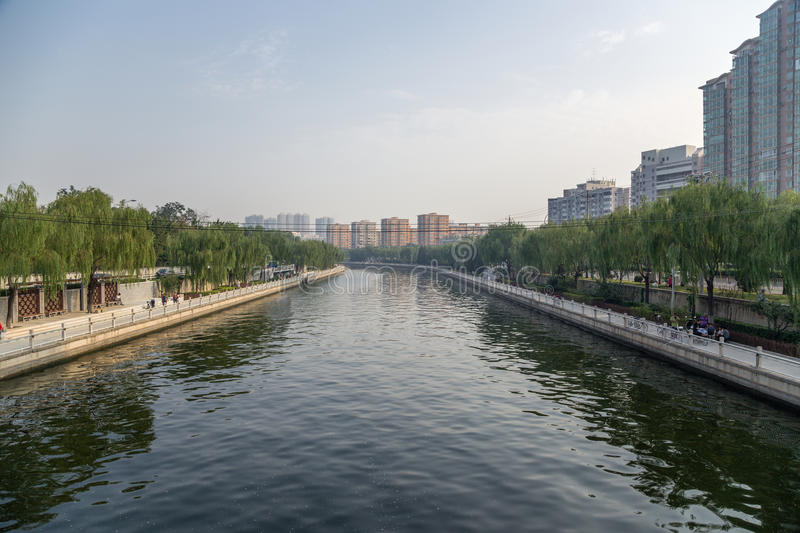 Beijing, China. Cityscape with river. Beijing, China. Urban landscape with river embankment in central stock photos