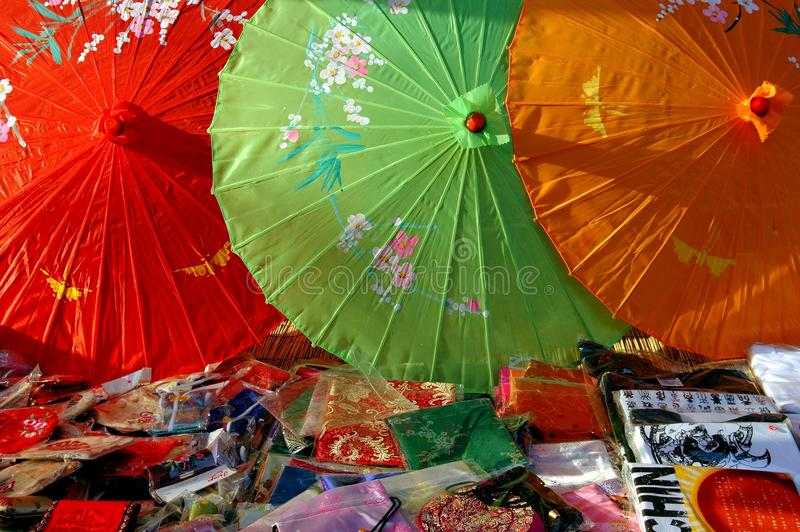 Beijing, China: Colourful Umbrellas. A display of colourful parasols, silk scarves, and souvenir tee-shirts sold at a shop in the famed Shi Sa Hai Hutong in stock photography