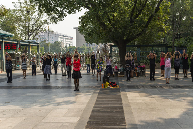 Beijing, China. Dancing as a healthy lifestyle. Beijing, China. Elderly Chinese dance flamenco in one of the city parks stock image