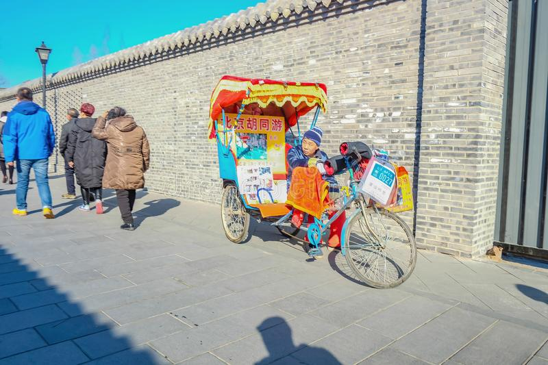 Nanlouguxiang pedicab or rickshaw tour in Nanlouguxiang Old Part area of the Beijing city centre stock image