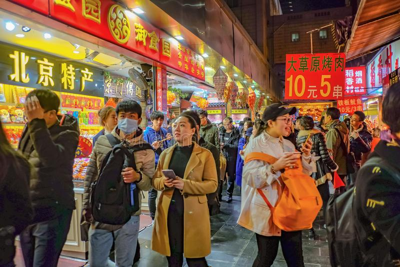 Unacquainted chinese Chinese people or tourist walking on Street food road wangfujing in beijing city,China travel. Beijing/China - 25 February 2017 stock images