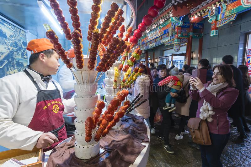 People at the Wangfujing Snack Street in Beijing stock image