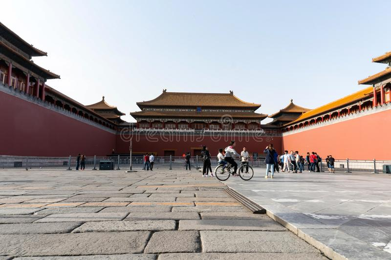 Beijing, China - May 3,2016 : Unidentified woman rides bicycle at Forbidden City in Beijing. Forbidden City was a former Chinese Imperial Palace from the Ming stock photos