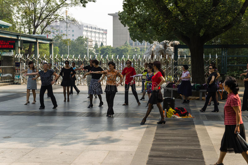Beijing, China. Spanish dancing as a healthy lifestyle. Beijing, China. Elderly Chinese dance flamenco in one of the city parks stock images