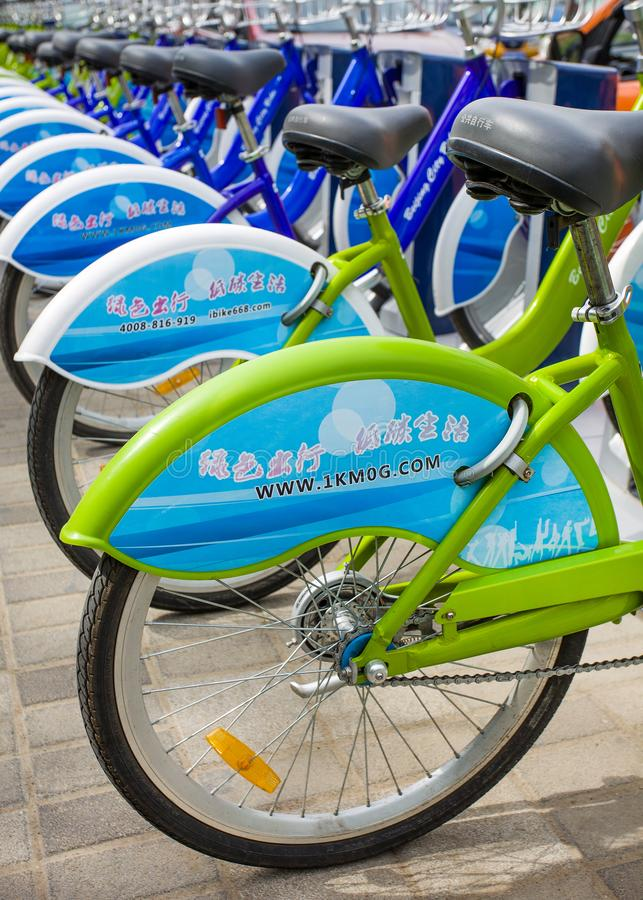 Chinese rental bicycles parked in public bicycle sharing station. BEIJING-MAY 5, 2015. Bicycles parked in public bicycle sharing station. Bicycle sharing allow stock images