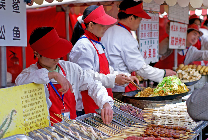 Beijing night snack market. A street food market in Beijing, offering kebabs, dumplings, noodles and other snacks royalty free stock images