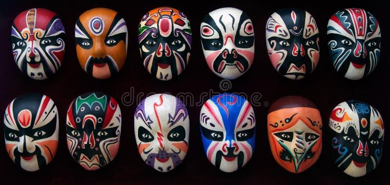 Beijing Opera Masks. Twelve different colour traditional Beijing Opera Masks decoration royalty free stock images