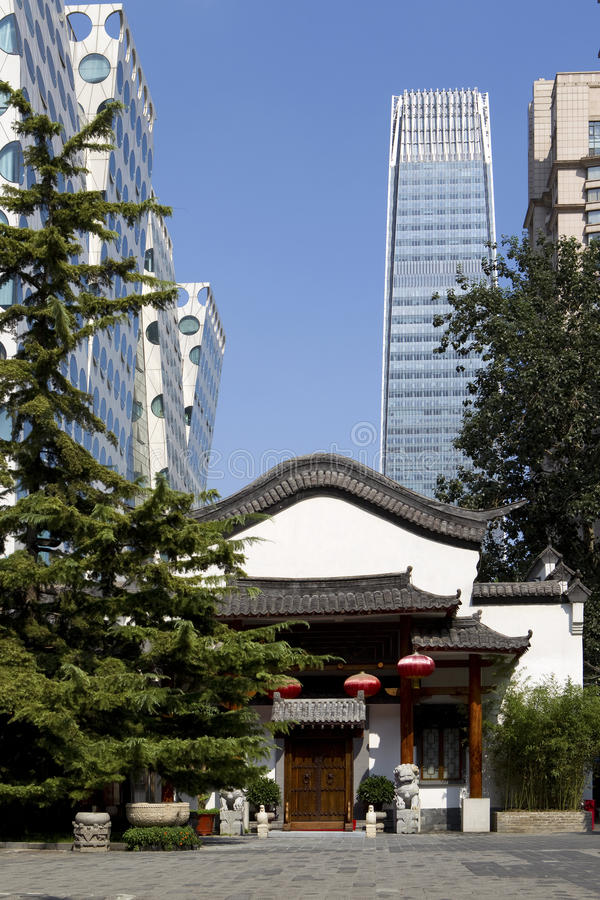 Beijing. Small traditional building surrounded by modern high rises, Beijing, China royalty free stock photography