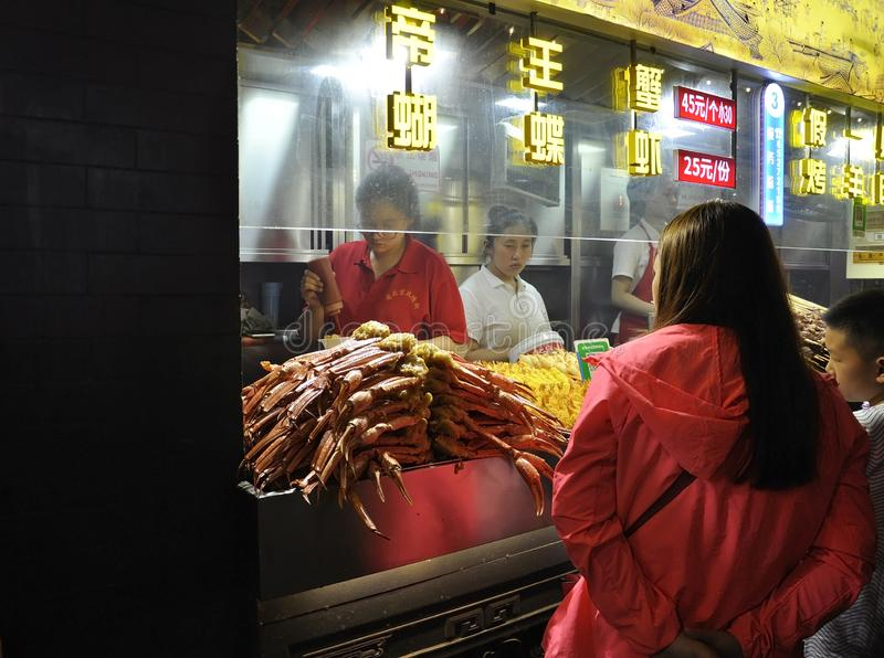 Beijing, 5th may: Food Stall from downtown Street Food by night of Beijing royalty free stock image
