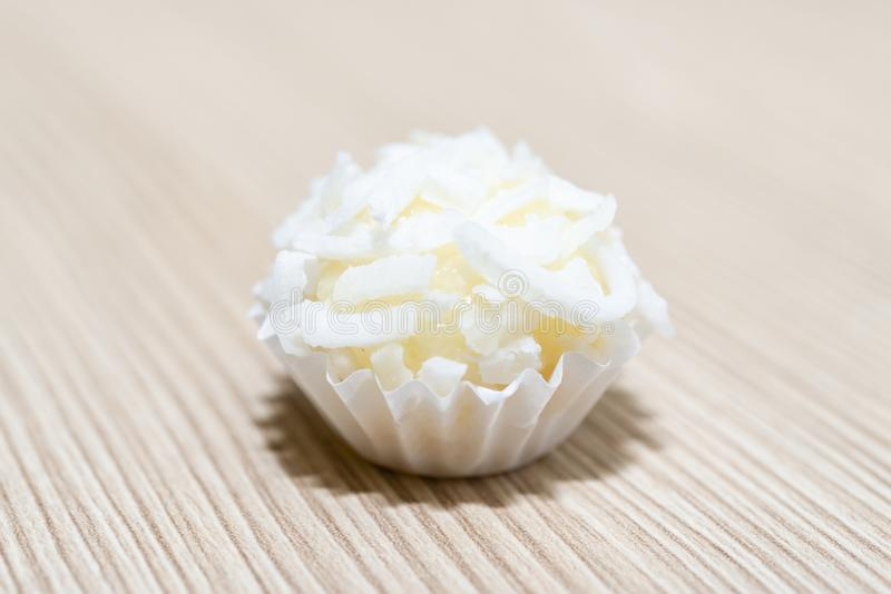 Beijinho is a handmade candy from Brazil. Made with condensed milk and coconut. Children brithday party sweet. Overhead of candy b royalty free stock photos