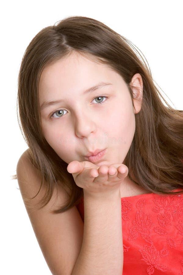 Beijo de sopro da menina imagens de stock