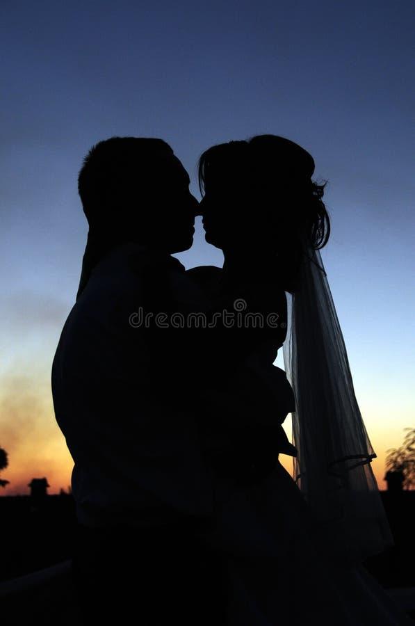 Beijo do por do sol foto de stock