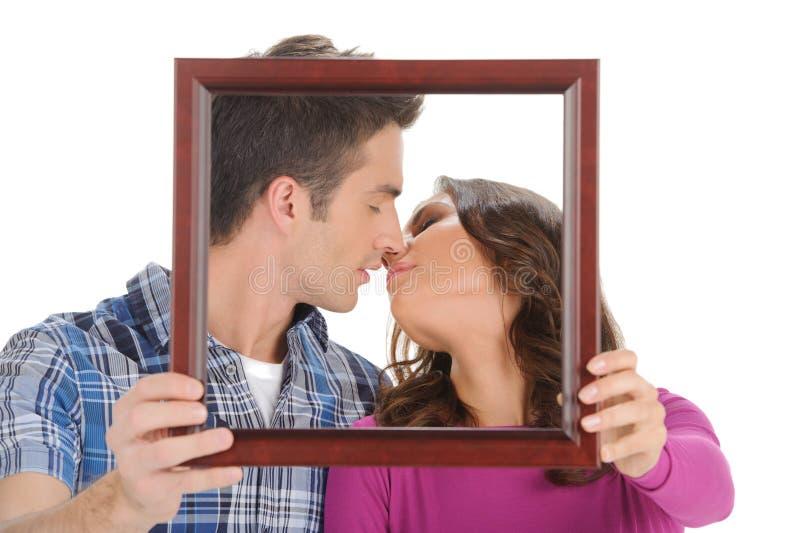 Beijo em uma moldura para retrato. fotografia de stock