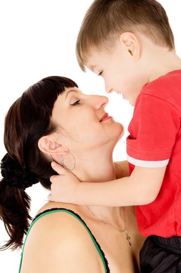 Beijo feliz da criança sua matriz fotografia de stock