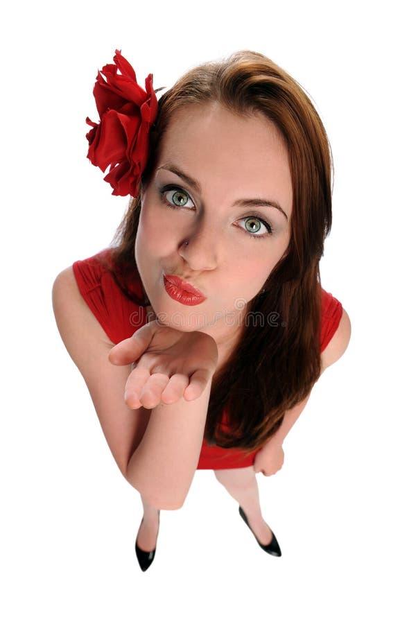 Beijos de sopro da mulher nova imagem de stock royalty free