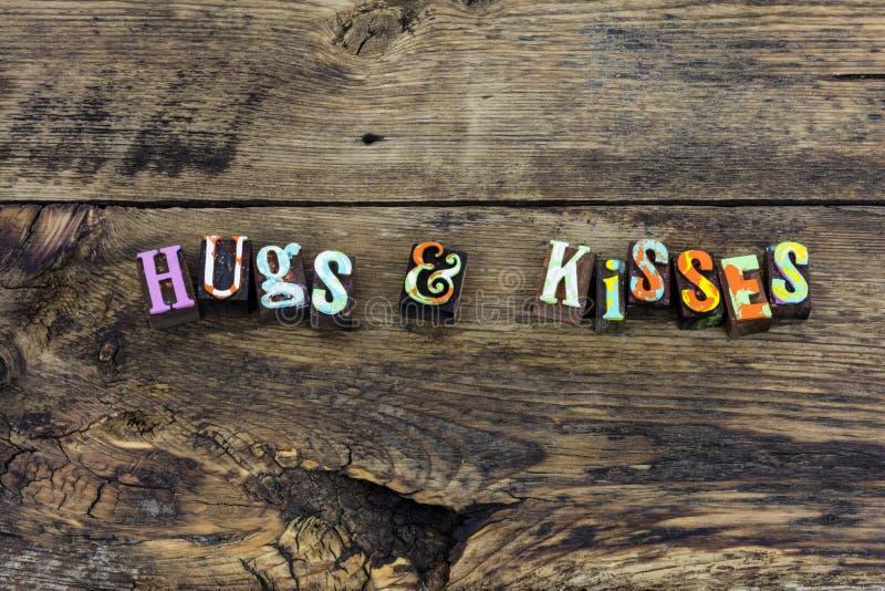 Beijos dos abraços que cumprimentam a tipografia bem-vinda do sorriso fotografia de stock