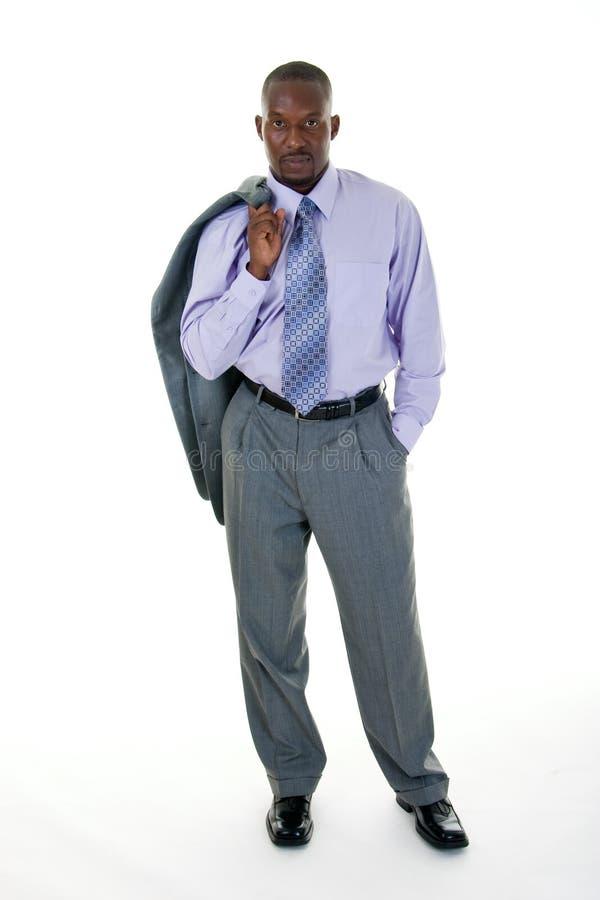 Beiläufiger Geschäftsmann in der grauen Klage stockfoto