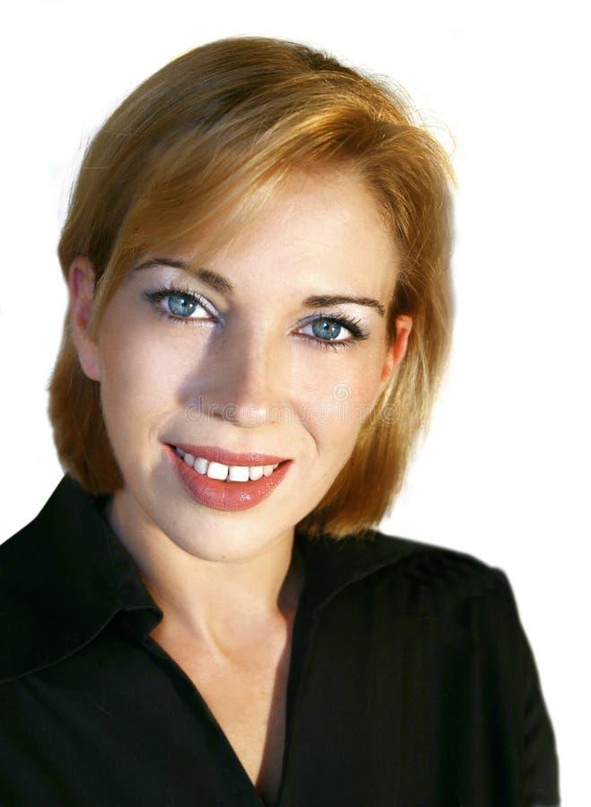 Beiläufiges Geschäftsfraulächeln lizenzfreie stockfotos