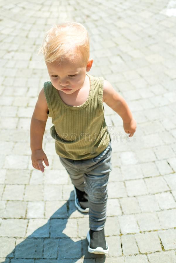 Being able to give good child care. Baby boy. Small baby on day care. Little baby walk outdoor. Improving child health. And growth. Emotional and physical stock image
