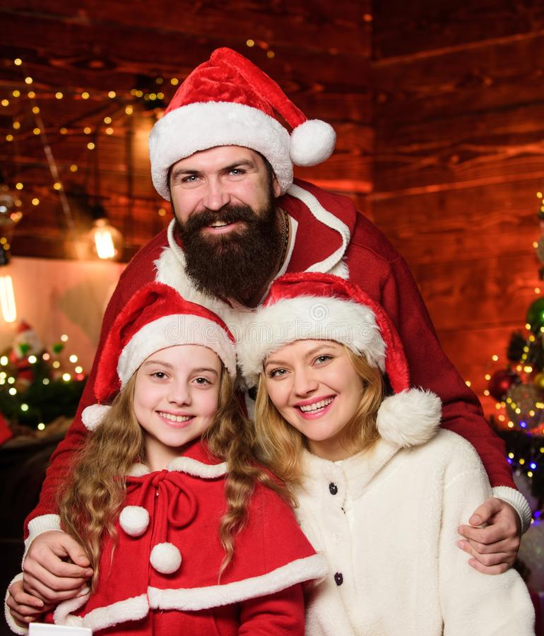 Being best Santa for them. Father Santa claus costume with family celebrating christmas. Lovely daughter with parents royalty free stock image