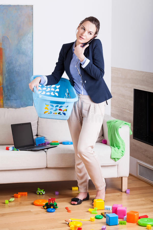 Being a businesswoman and young housekeeper. Vertical royalty free stock photos