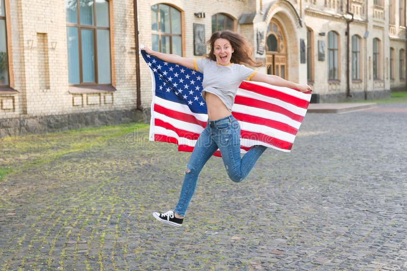 Being free and live life fully. Happy girl jumping free with american flag outdoor. Sensual woman celebrating freedom stock photo