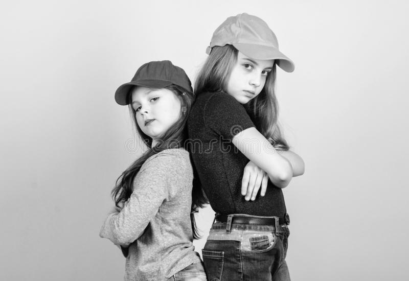 Being a hipster. Adorable little hipsters. Little children wearing hipster style clothing and accessories. Cute small stock photo