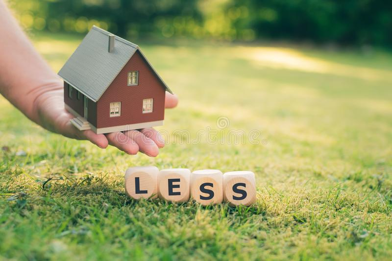 Being homeless concept. A model home and cubes create the expression `homeless stock image