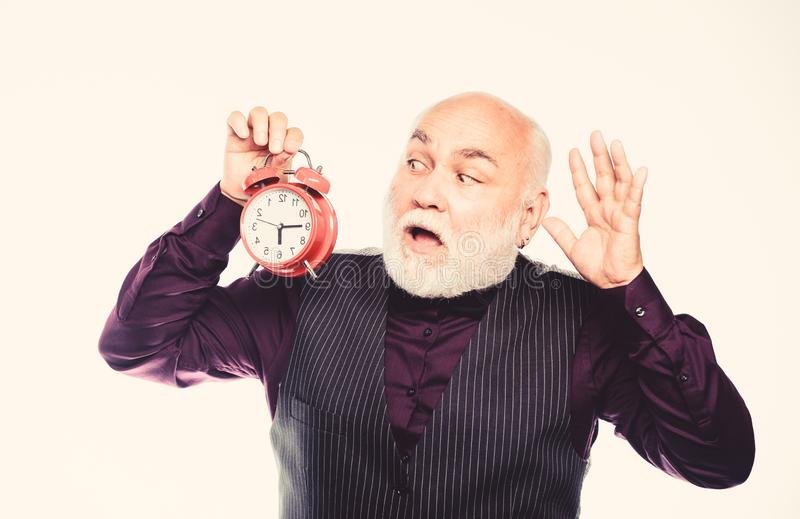 Being late is habit. time management. business startup. retirement. watchmaker or watch repairer. mature man with beard royalty free stock images