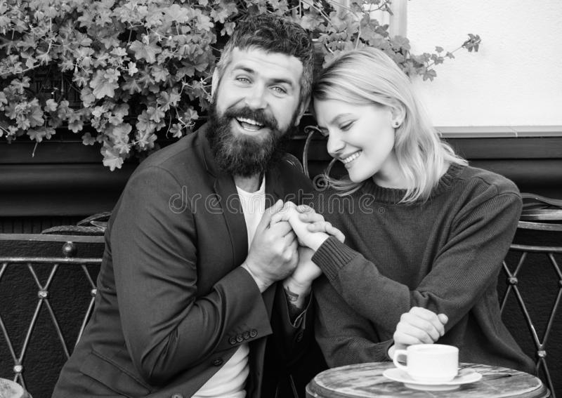 Being in love. Morning coffee. woman and man with beard relax in cafe. First meet of girl and mature man. happy couple stock photo