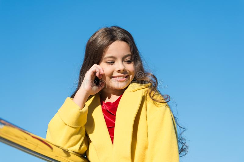 Being proud of her hair. Little child with stylish long brunette hair. Fashion look of hair model. Small girl with royalty free stock photos