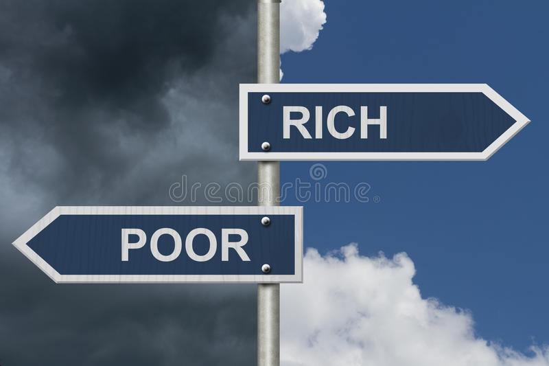 Being Rich Versus Poor. Two Blue Road Signs with text Rich and Poor with sky background stock photography
