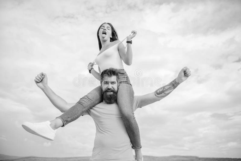 Being on the same wave. Happy couple in love on cloudy sky. Loving couple happy smile having fun. Bearded man. Being on the same wave. Happy couple in love on royalty free stock images