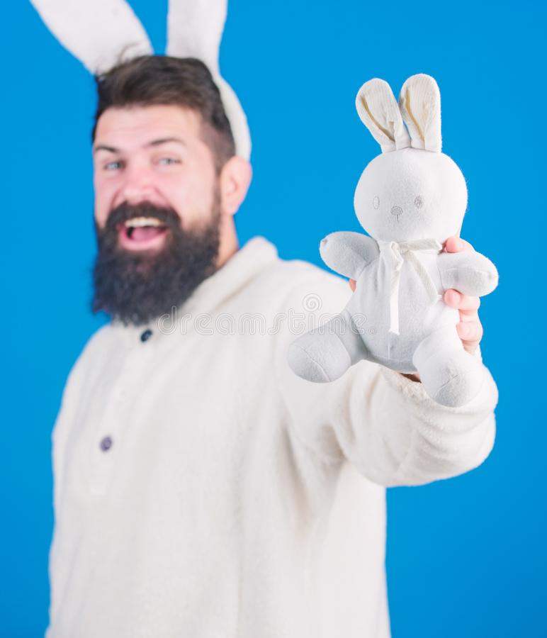 Being soft in white fur. Easter rabbit is symbol of Easter and spring. Bearded man in easter rabbit costume with hare royalty free stock photo