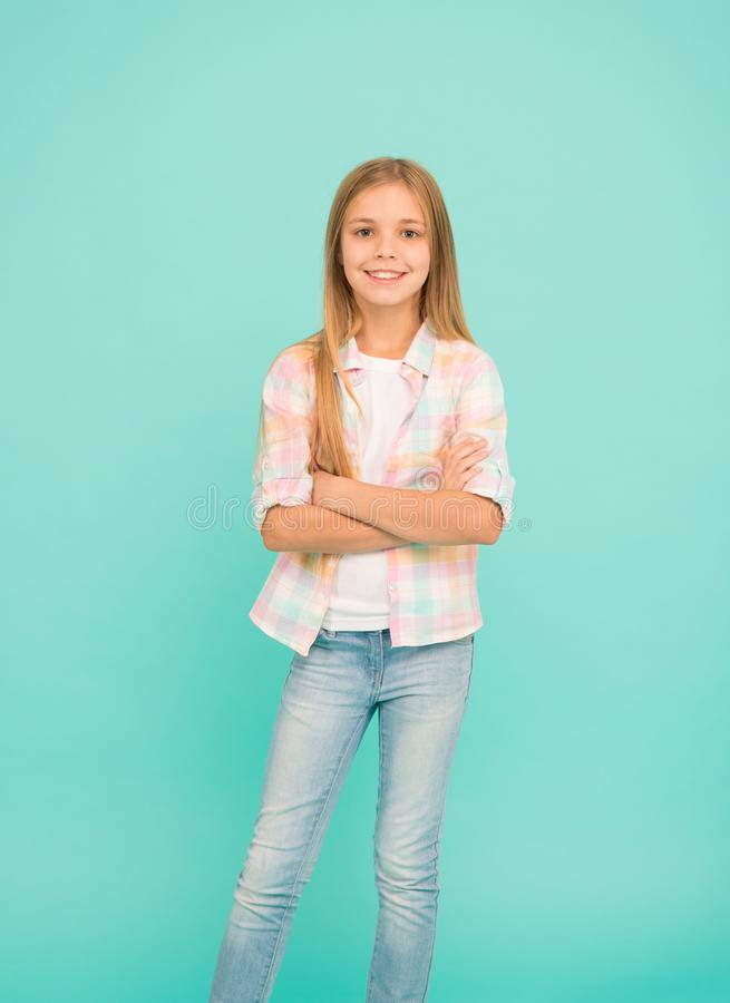 Being used to model clothes. Small child wearing casual style. Fashionable little girl child. Little girl with long. Blond hair. Small fashion model with beauty royalty free stock image