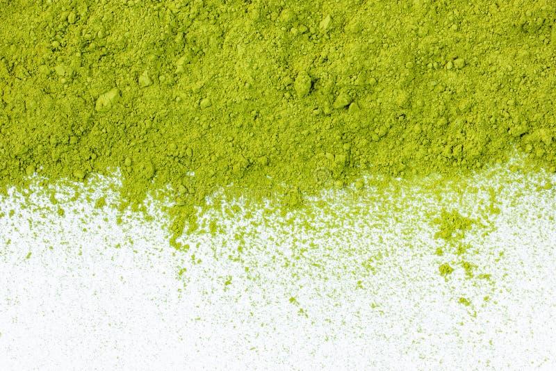 Beira do fim pulverizado da opinião superior de chá verde acima fotos de stock royalty free