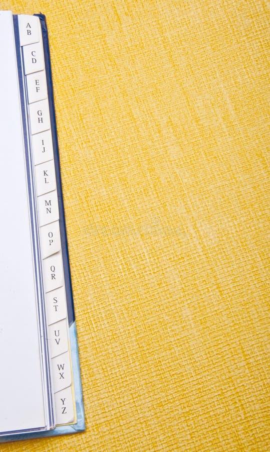 Beira do livro de endereço no amarelo vibrante imagens de stock