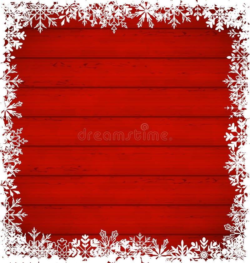 Beira dos flocos de neve do Natal no fundo de madeira