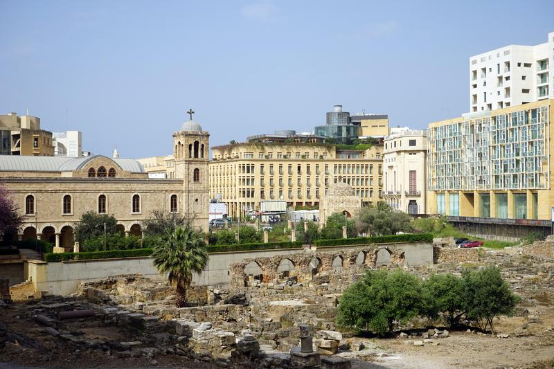 Roman ruins. BEIRUT, LEBANON - CIRCA APRIL 2019 Roman ruins in front of Mohammad Al-Amin mosque and Saint Georges Maronite & Orthodox Cathedrals in downtown stock image