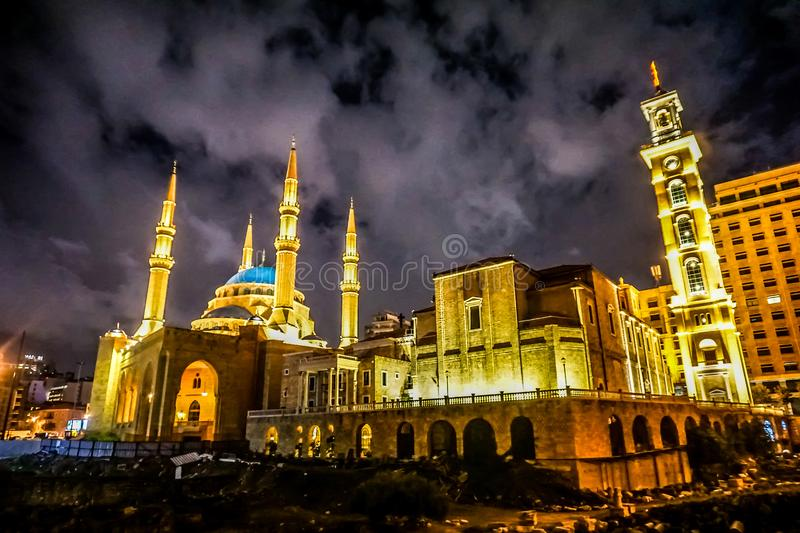 Beirut Saint Georges Maronite Cathedral 05. Beirut Saint Georges Maronite Cathedral Illuminated at Night with Mohammad Al Amin Mosque stock image