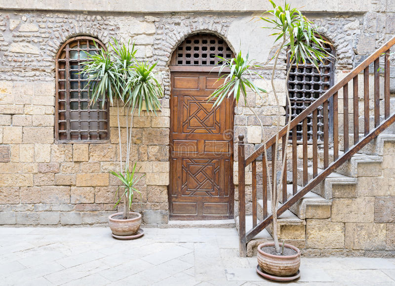 Beit El Set Waseela Waseela Hanem House, Medieval Cairo, Egypt. Facade of Beit El Set Waseela Waseela Hanem House, showing a wooden closed door and two window royalty free stock images
