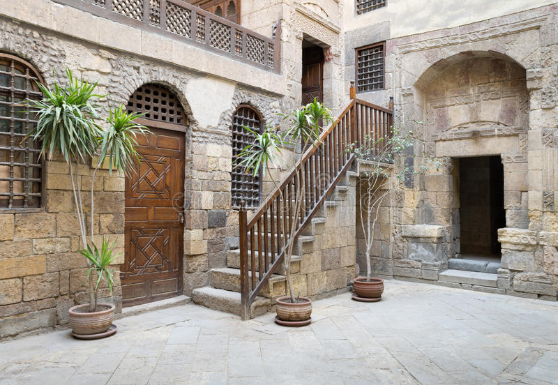 Beit El Set Waseela Waseela Hanem House, Medieval Cairo, Egypt. View of the courtyard of Beit El Set Waseela Waseela Hanem House, showing a wooden closed door royalty free stock photo