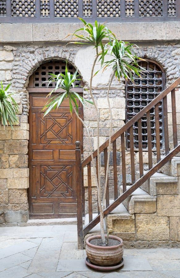 Beit El Set Waseela Waseela Hanem House, Medieval Cairo, Egypt. View of the courtyard of Beit El Set Waseela Waseela Hanem House, showing a wooden closed door stock images