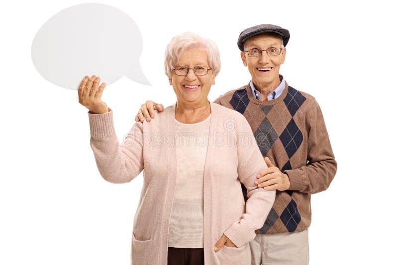 Bejaard paar met een toespraakbel stock afbeeldingen
