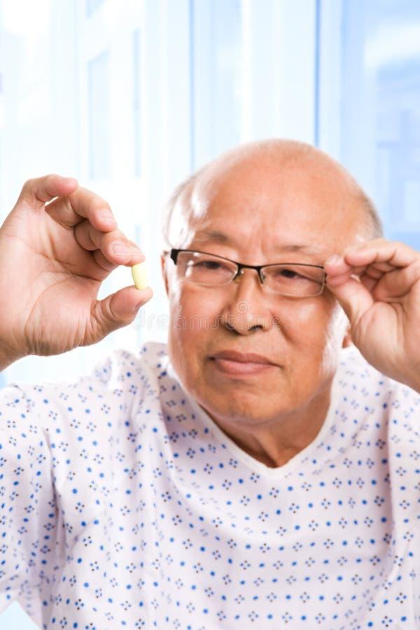 Bejaarde Aziatische gezondheidszorg royalty-vrije stock afbeelding