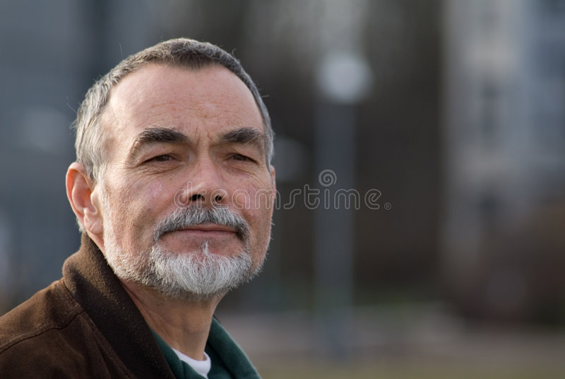 Bejaarde in jasje royalty-vrije stock afbeeldingen