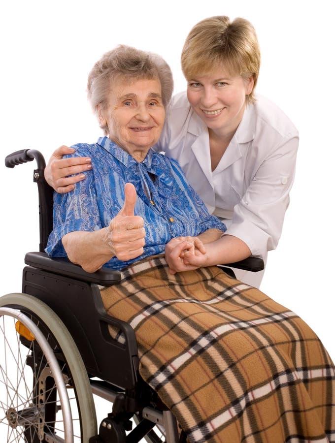 Bejaarde in rolstoel royalty-vrije stock afbeelding