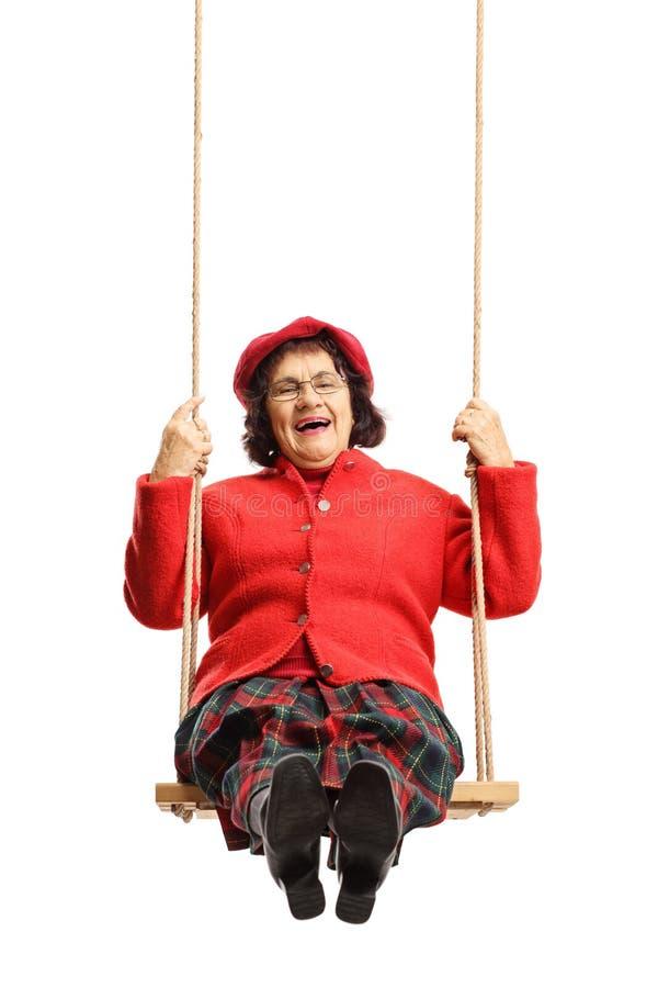 Bejaarde vrolijke dame op een schommeling royalty-vrije stock foto's