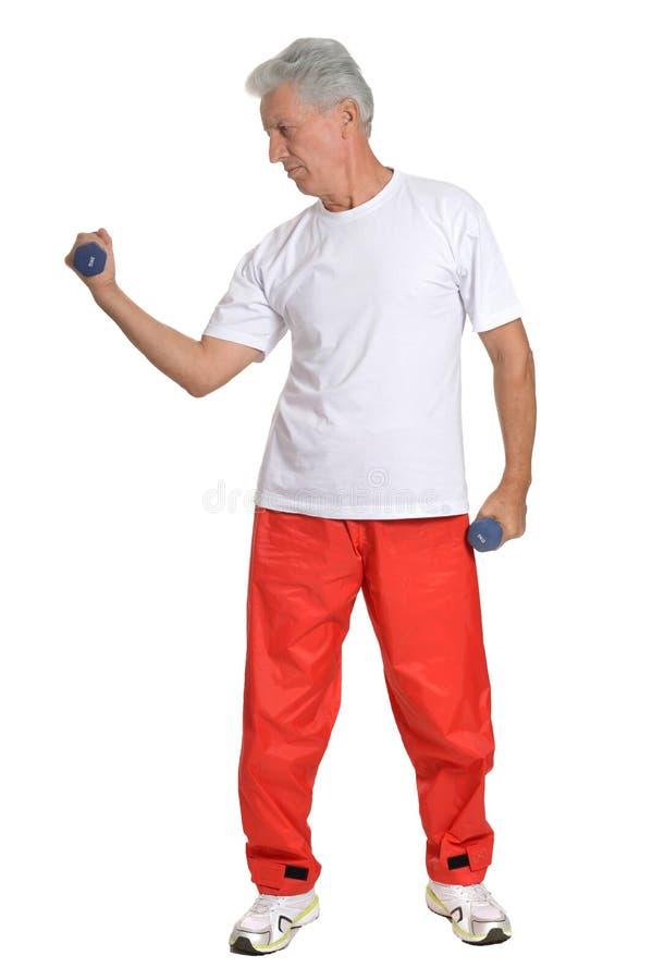 Bejaarden belast met sport op een wit stock foto's