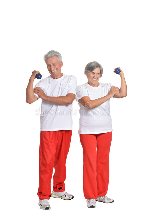 Bejaarden belast met sport op een wit stock afbeeldingen